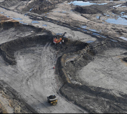 dump truck hauling away spoil and oil/tar sands. Image: Edward Burtynsky