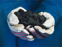 A handful of tar sands. Image credit: ostseis.anl.gov
