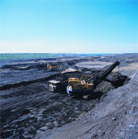 Open-cast mining of tar sands. Image credit: A handful of tar sands. Image credit: ostseis.anl.gov