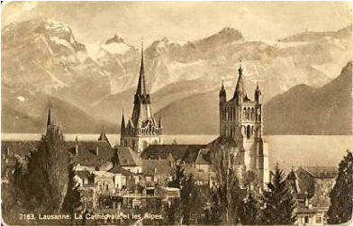 1924 'real photo' of Lausannre cathedral, with lake Geneva and the Alps beyond