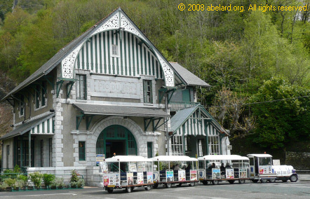 Petit train  		touristique, this one is outside Lourdes funicular railway station
