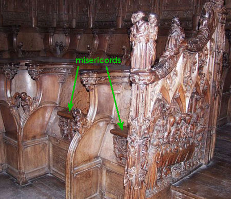 Two choir stalls at Amiens cathedral with their misericords marked.