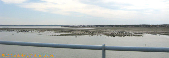 Oyster beds in in the straits between island and mainland, seen from the Ile d'Oleron bridge