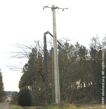 Broken electricity pylon with replacement, February 2009