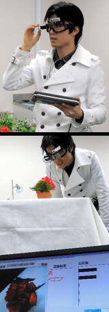 Using the cyper goggles to see and label a plant. Credit: http://www.asahi.com/