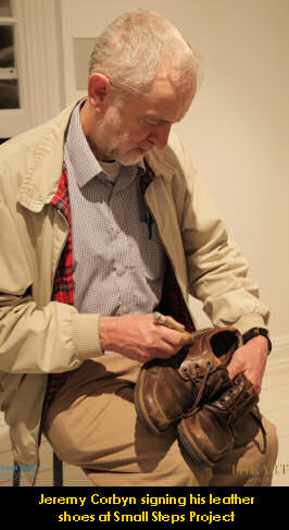 Jeremy Corbyn signing his leather shoes at Small Steps