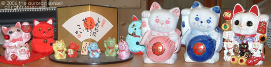 Some of my maneki-neko collection. Image credit: the auroran sunset
