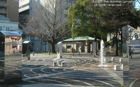 A concrete city park with a painted maze and mirrored art, Yokohama, Tokyo, Japan. Image credit: the auroran sunset